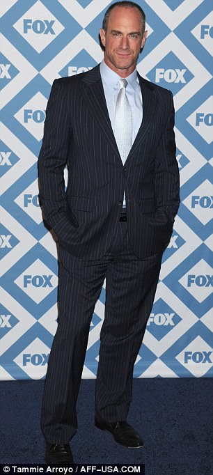 Promotional duties: Matthew Rhys wore a blazer and jeans and Christopher Meloni sported a pinstriped suit and light blue shirt