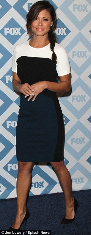 Delight in black and white: Vanessa Lachey wore a slinky striped short sleeved dress and black heels