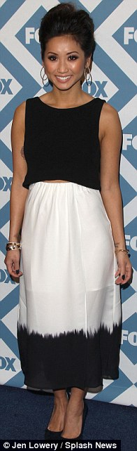 Dressed to impress: Brenda Song wore a black and white midi dress