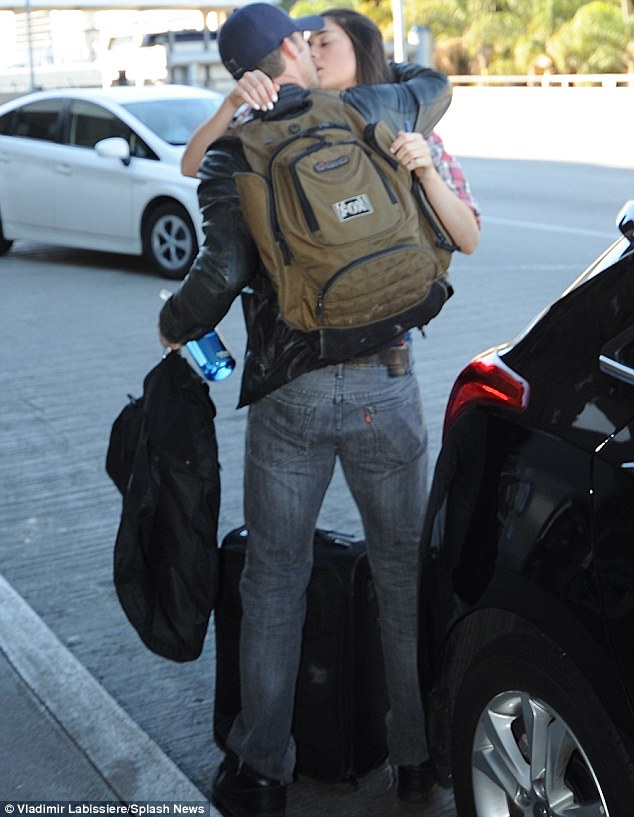 A kiss farewell: Jesse Spencer was spotted getting a smooch from a mystery brunette at LAX