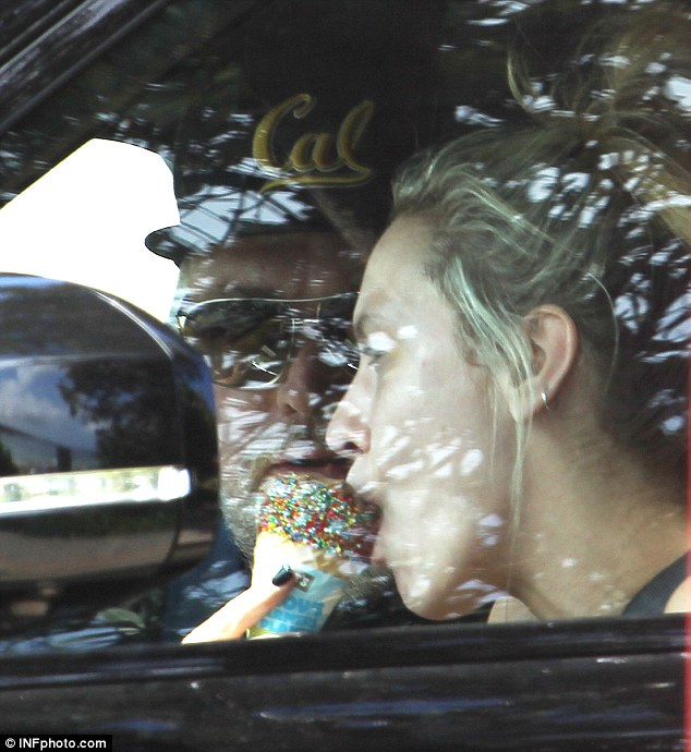 Keeping cool: Imogen was seen indulging in a vanilla cone in the comforted of Kyle's air conditioned Range Rover