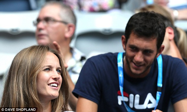 All smiles: Kim chats to James Ward, the British no. 3 behind Andy Murray and Dan Evans, as they watch the match