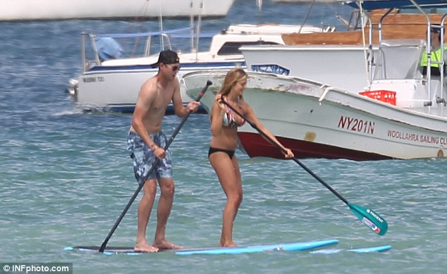 Paddling along: Stuart Broad and companion Lexi Penwill take a break in Sydney Harbour