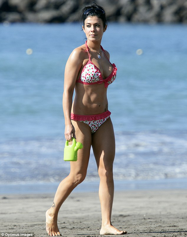 Disciplined: Kym's svelte appearance on the beach comes amid claims that she's throwing herself into a diet and exercise plan in the wake of her split from Jamie