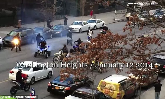 Dangerous: The video, taken Sunday by a nervous neighbor and posted on YouTube, shows the group of daredevils blocking a section of Broadway around West 190th Street