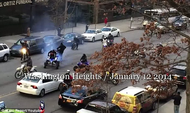 Again: Out-of-control motorbike riders, pictured, returned to a busy stretch of Manhattan's Washington Heights Sunday, blocking drivers and terrifying onlookers