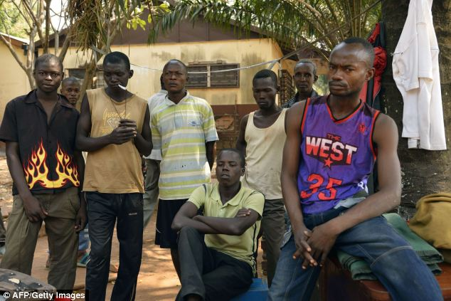 Former Seleka rebels gathered in camp Beal in Bangui pose after the resignation of the ex-rebel Central African president