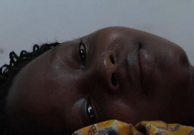 The young girl alternated between writhing on the bed in agony and staying silent as tears fell down her face as she gave birth to a son she did not want