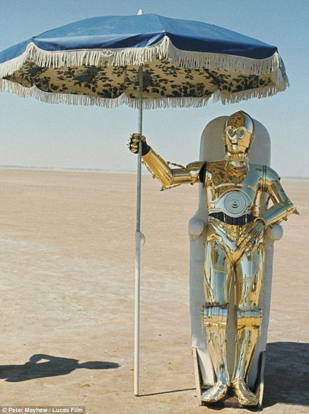 He's melting: C-3PO tried to cool off with the help of a table umbrella while in the desert