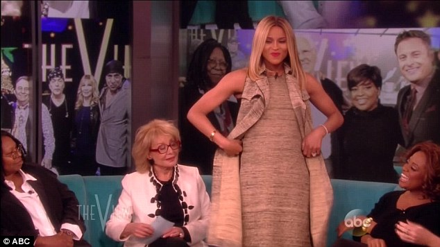 The big reveal: The Grammy winner announced her pregnancy on Tuesday's episode of The View by letting her bump do the talking