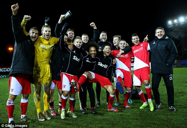 Up for the Cup: Kidderminster players celebrate on the pitch as they look to repeat their exploits from 1994