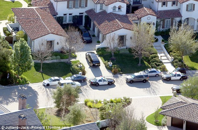 Police arrive to raid Justin Bieber's Calabasas mansion after Los Angeles law enforcement executed a felony search warrant early on Tuesday morning