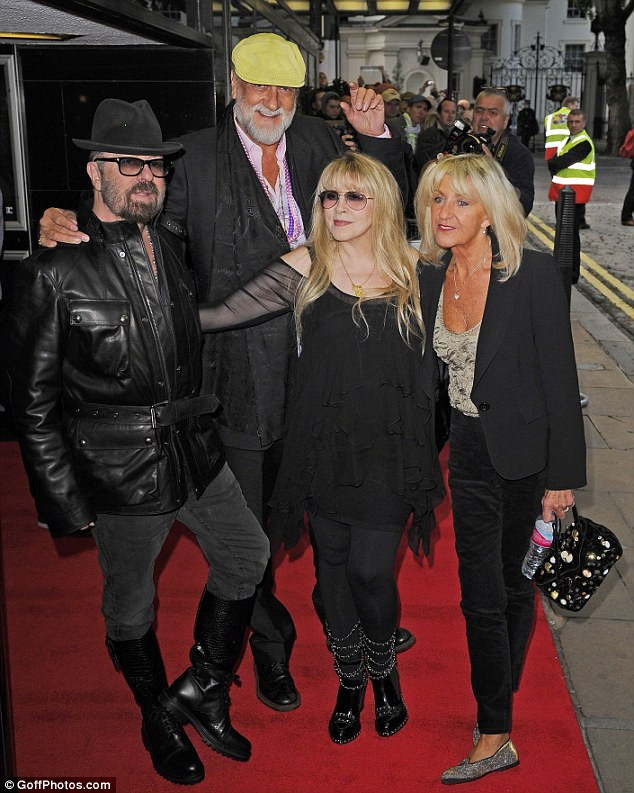 It's official: Christine McVie has rejoined Fleetwood Mac; the 70-year-old singer is pictured with, L to R, pal Dave Stewart and band members Mick Fleetwood and Stevie Nicks at an event in London on September 16