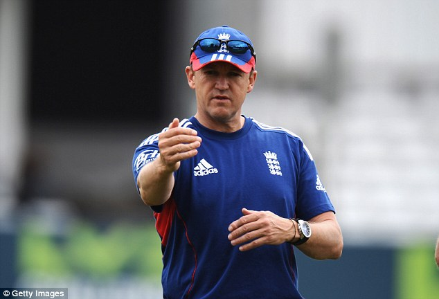 Holding on: Andy Flower has still got his job as England Test coach despite an Ashes thrashing