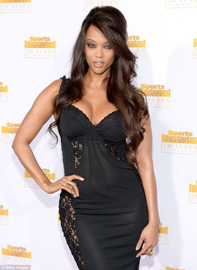 Sexy: The 40-year-old supermodel wore a dress that resembled a lacy black negligee, which hugged her curves and boosted her ample cleavage