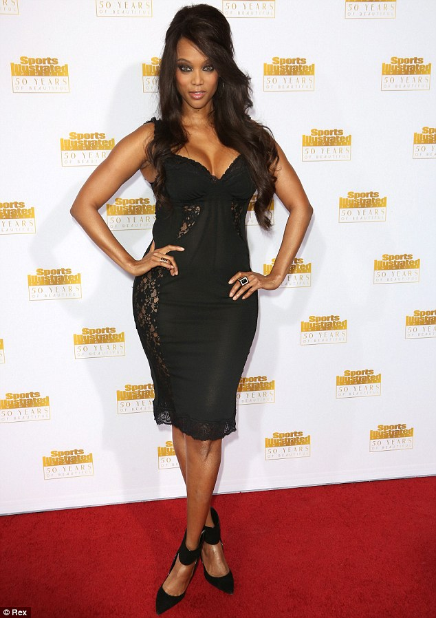 Fabulous at 40: Tyra Banks showed her beauty undiminished since her days of posing on the cover of the Sports Illustrated Swimsuit Issue during its 50th anniversary celebration in Los Angeles on Tuesday