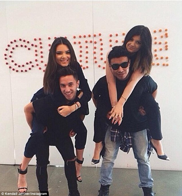 Jenner Girls: Before their pow-wow with the 38-year-old funnywoman, Kendall and Kylie got a piggyback ride from their 'glam [squad]'s back'