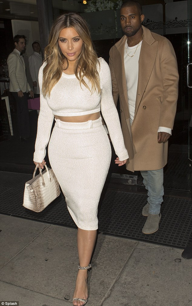 She's in fashion: Kim, pictured in a white long sleeved crop top and skirt ensemble after dinner with Kanye at  Mr Chow in Beverly Hills on Sunday