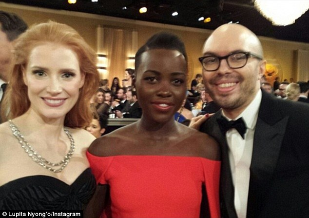 Star struck: With her best friend Ben Kahn (R) by her side, the Shuga actress used the glitzy awards show as a chance to meet her favourites like Jessica Chastain (L)