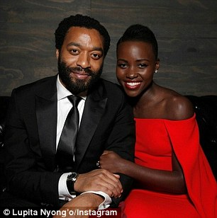 'A woman I love': Nyong'o also took snaps with her co-stars Sarah Paulson - whose character viciously torments Patsey - and Chiwetel Ejiofor