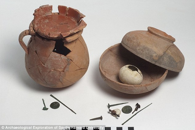 Buried beneath the ancient Turkish city of Sardis, archaeologists have discovered two pots dating back 2,000 years. The pots, pictured, are relatively intact and contain the remains of a perfectly preserved eggshell which may have been used to ward off evil spirits