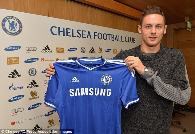 Blue is the colour: Nemanja Matic poses with the Chelsea shirt after completing his £21m move