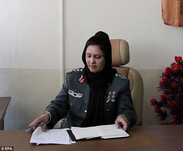 Colonel Jamila Bayaz, the newly appointed head of police, attends her office in Kabul