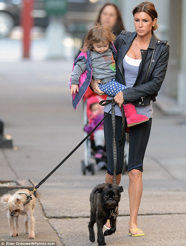 Pet pooches on parade: The former mistress of Tiger Woods  failed to raise a smile during her stroll around town