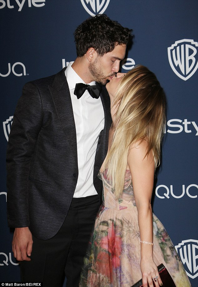 Sealed with a kiss: The happy couple shared a tender peck on the red carpet at a Golden Globes after party on Sunday
