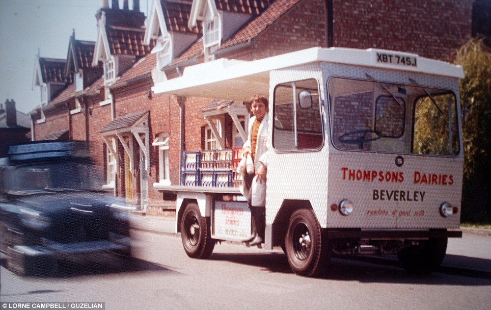 Doing the rounds: A milk-man gets ready to deliver the bottles to the doorstep. The tradition might be a thing of the past but the archives of the Thompson Dairy in Beverley, East Yorkshire, are preserving the memories