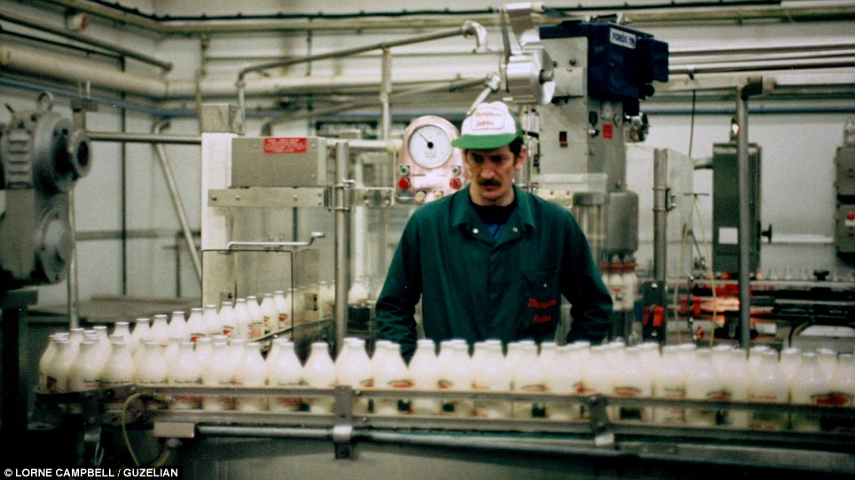 Quality control: An employee in the Figham Road dairy is pictured in the 1980s inspecting the milk before it was taken out on the rounds in East Yorkshire. The Thompson Dairy ceased business in 1992