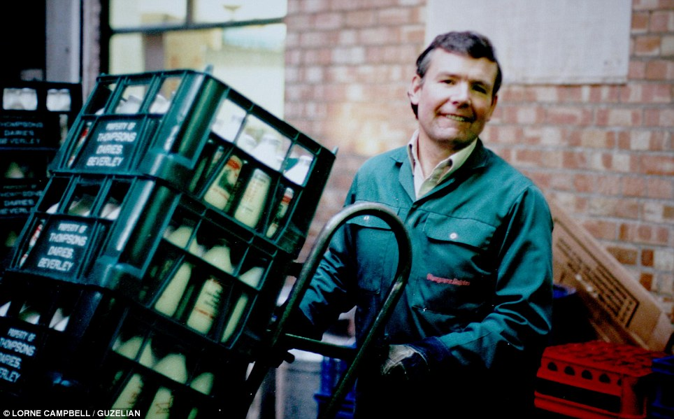 Carrying the load: One of the dairy's workers, Fred Gollagher, is pictured with crates of milk bottles ready for delivery