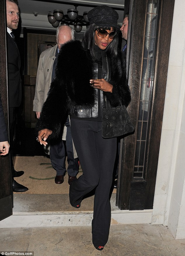 Supermodel exit! Naomi Campbell left the restaurant dressed entirely in black
