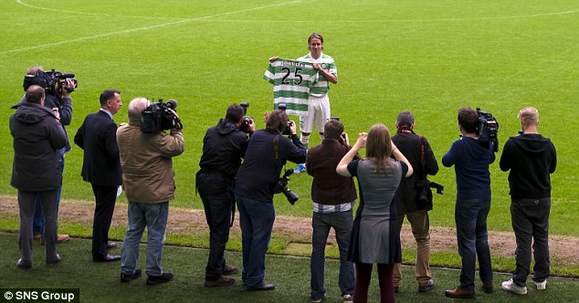 Main man: Johansen was centre of attention for the photographers at Celtic Park