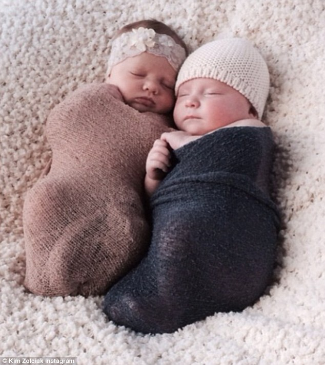 Little bundles of joy: Kim Zolciak shared a snap of twins Kane and Kaia swaddled in blankets to her Instagram on Wednesday