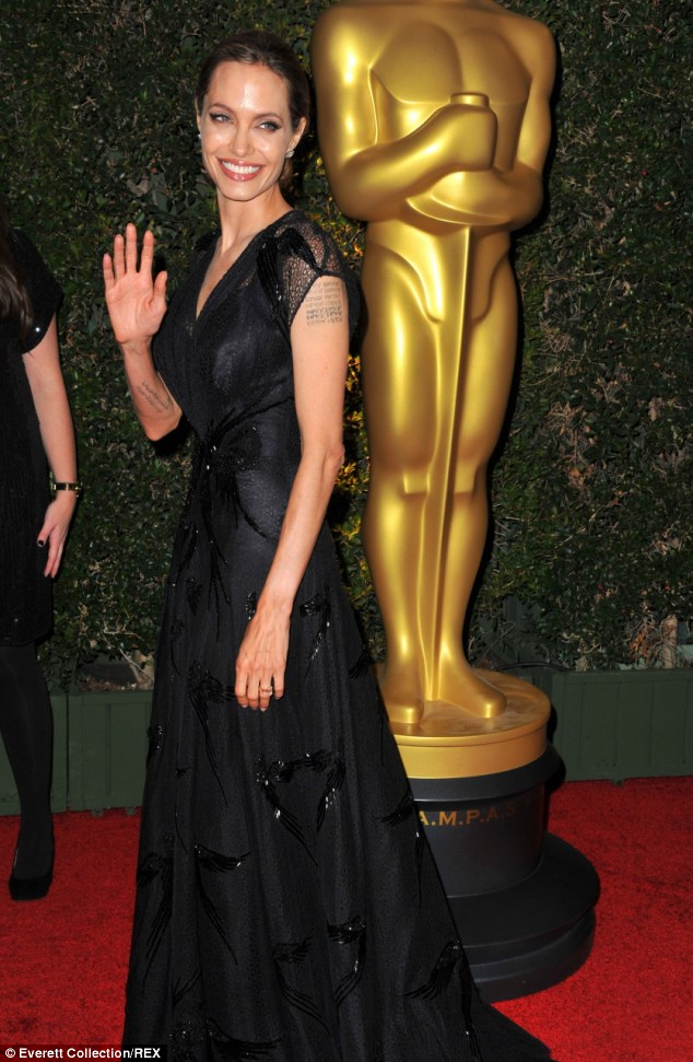Show stopping: Angelina Jolie at the Academy Motion Picture Arts and Sciences 5th Annual awards in Los Angeles where she scooped the Jean Hersholt Award for her international humanitarian efforts in November