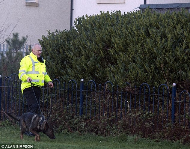 Tracks: Search teams at work as police in Edinburgh are appealing for witnesses to help trace the missing child