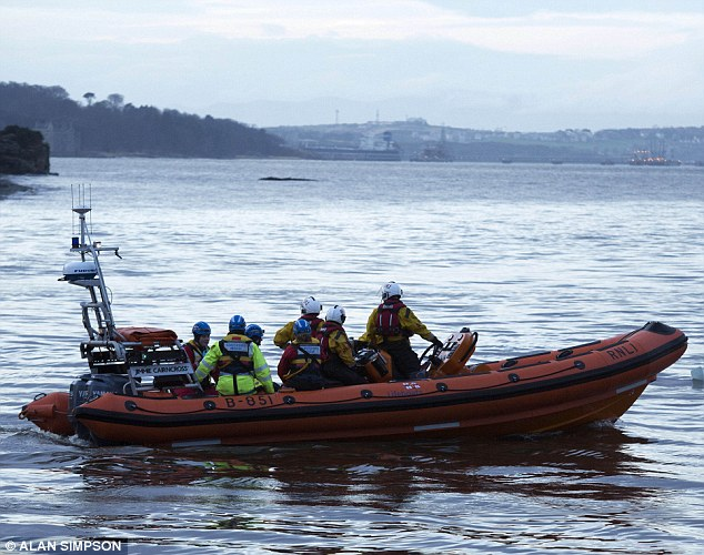 On the water: Coastguard Search and Rescue set off in their boat at Crammond Beach as search for the missing boy in Edinburgh continued this evening