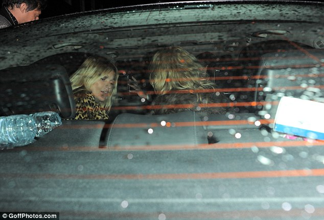 Don't rain on my parade! Kate leaves the restaurant and gets into a waiting car