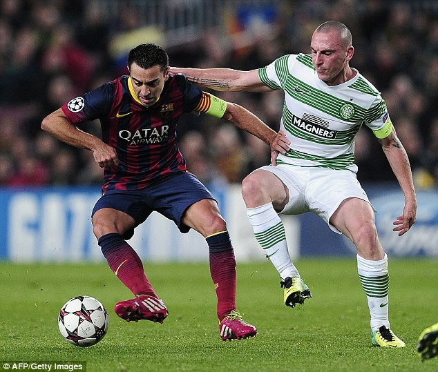 Playmaker: Xavi in action against Celtic in the Champions League at the Nou Camp in December