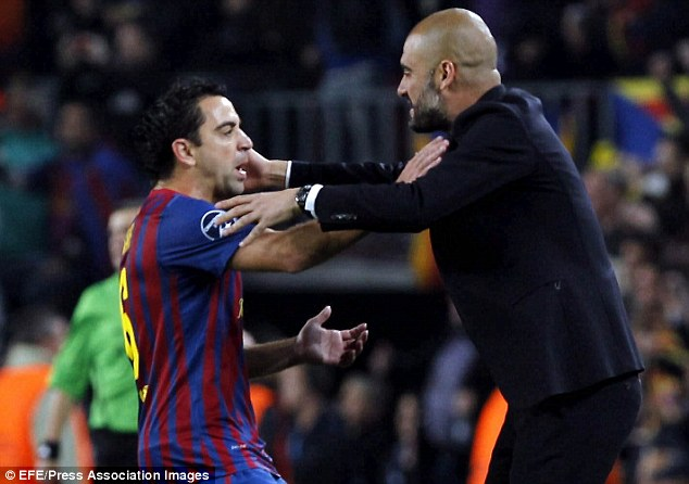 Dream team: Xavi's brilliant passing ability helped Pep Guardiola (right) conquer Europe with Barca