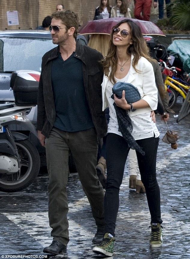 Manly men: Madalina has a definite type and dated Scottish hunk Gerard Butler last year; the pair were spotted in June sightseeing in Rome, Italy