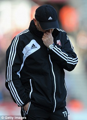 Tony Pulis looks dejected in defeat