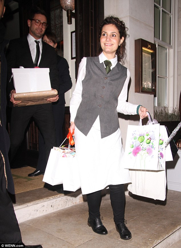 So many gifts: The model's presents were carried out by hotel staff after her party