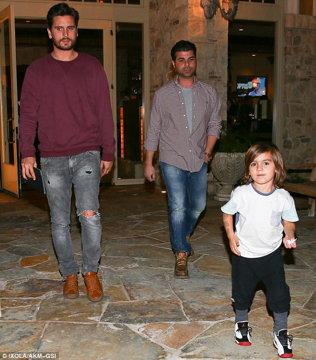 Seeking solace: Grieving Scott Disick shared a meal with his son Mason in Los Angeles on Thursday