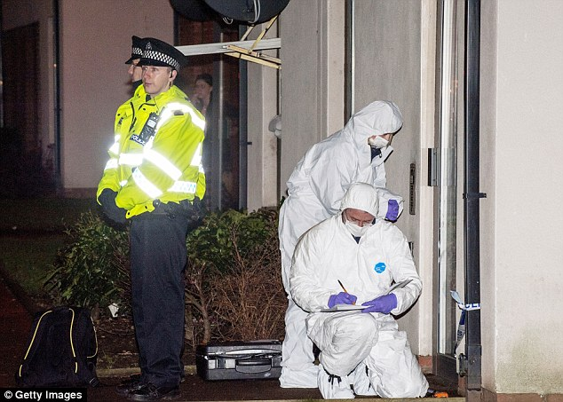 Police and forensic officers look for clues at the home of Mikaeel Kular where he went missing in Edinburgh