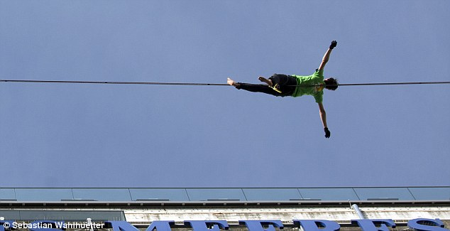 Scotland lying down on the tight rope, resting before the next bit of the stunt