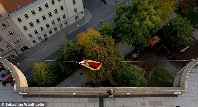 Sleep tight, dont let the seagulls bite: Thrillseeker Igor Scotland rigged up his highline and secured a red and yellow hammock to it before enjoying some all-important me time