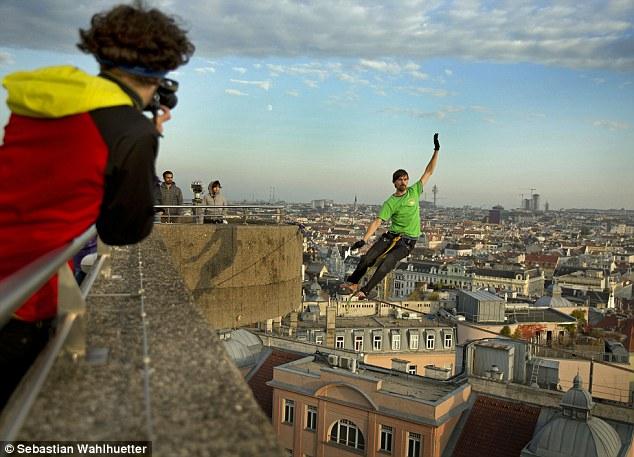 Igor Scotland balances on the highline as horrified citizens look on