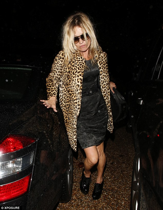 Hold steady! Kate Moss wears her sunglasses to hide her tired eyes after partying hard for her 40th birthday